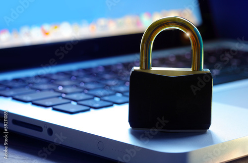 .Padlock on computer keyboard