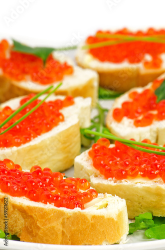 Snacks with Red Caviar, Butter, Parsley and Baguette