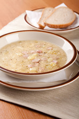 Potato soup with sausage and bread