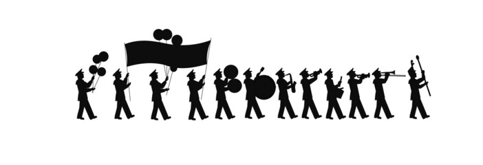 large marching band in silhouette with banner