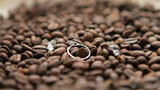 set of wedding rings on coffee beans