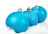Three blue Christmas ball on white fur