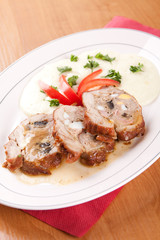 Veal roulade stuffed with minced meat and mashed potatoes