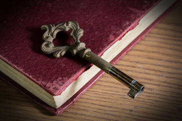 Old key on antique book