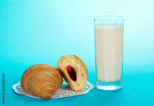 Leinwandbild Motiv Glass with milk and croissants, a napkin