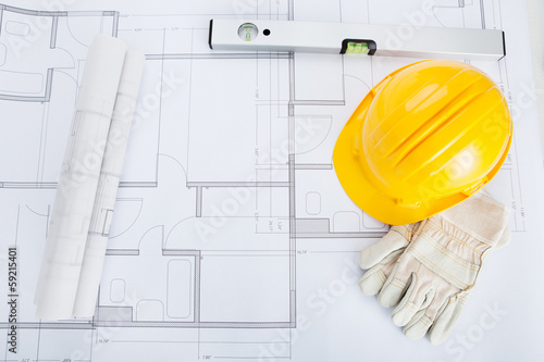 Close-up Of Blue Print And Hard Hat