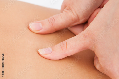 Person Receiving Shiatsu Treatment
