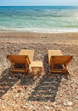 Two wooden sun loungers on the Adriatic Sea coast