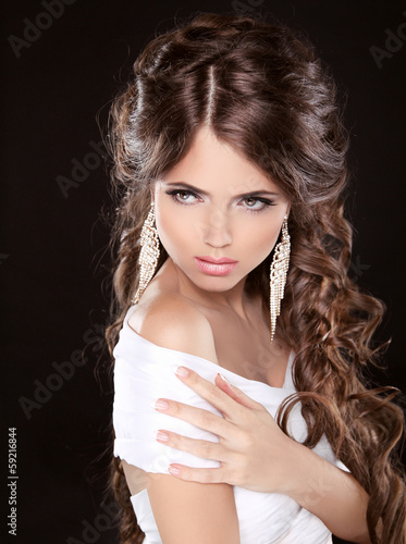 Beautiful woman with curly hair and evening make-up isolated on