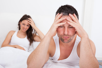 Frustrated Couple On Bed