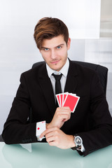 Businessman With Playing Cards In Sleeve