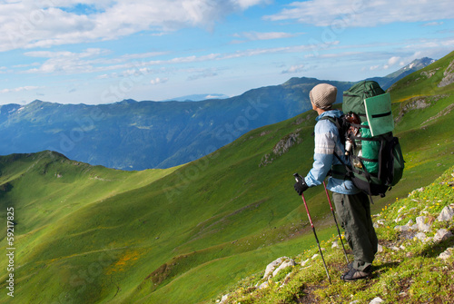hiker with backpack in a mountains