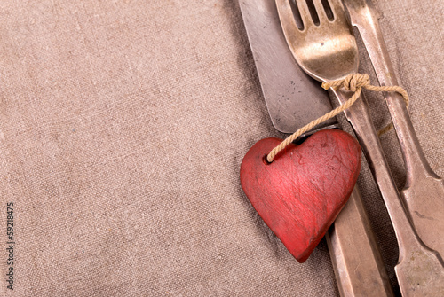 Silverware and red wooden heart