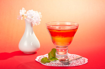 Glass with jelly, spearmint and a spoon