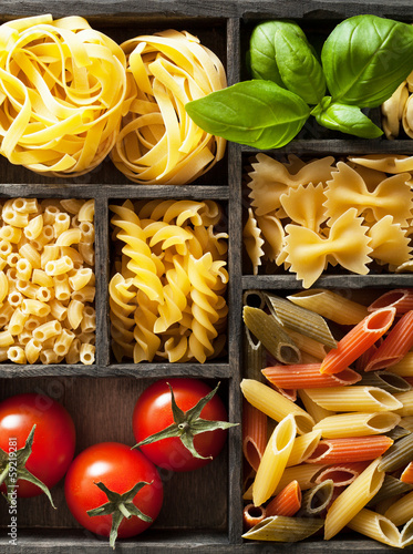 various pasta in black wooden box