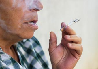 Senior woman smoke a cigarette