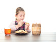 child drink tea with cookies and honey