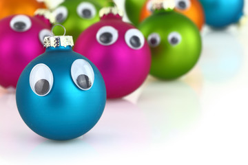 Colorful cute Christmas balls with eyes isolated on white