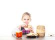 child eats honey