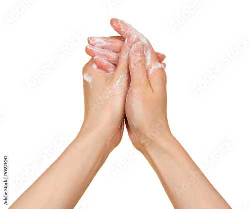 Woman washes her hands with soap