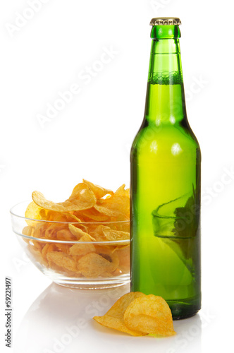 Bowl with chips and wet bottle of beer
