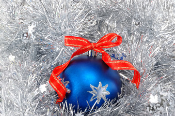 blue Christmas ball with red ribbon