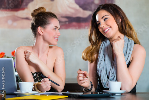 Students or businesswomen working in cafe