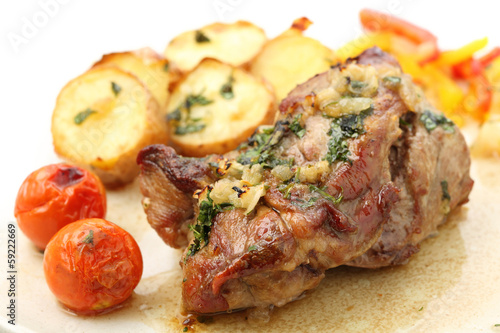 canvas print picture roasted pork with potatoes isolated on white (top)