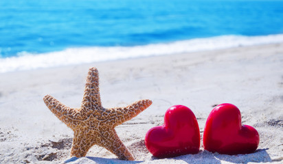 Starfish with hearts by the ocean