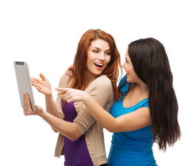 two smiling teenages with tablet pc computer