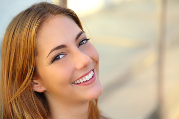 Beautiful woman with a perfect white smile and smooth skin