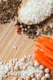 Ingredients for Uzbek pilaf on wooden background
