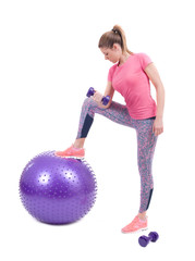 Sport woman exercise with a pilates ball and dumbbells