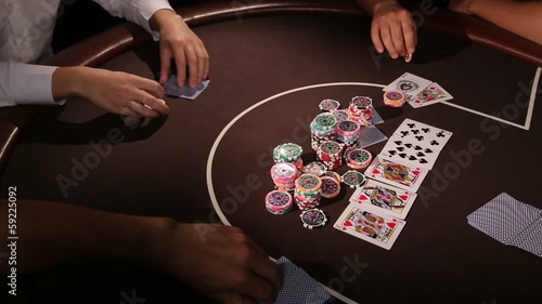 Casino. A group of adults playing texas holdem poker