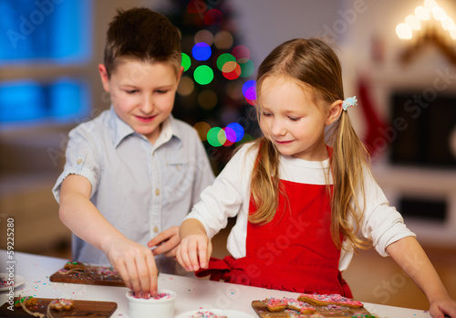 Kids baking Christmas cookies