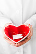 red heart shape with empty label in hands