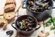 Mussels served with bread for dinner