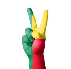 Hand making the V sign, Benin flag painted