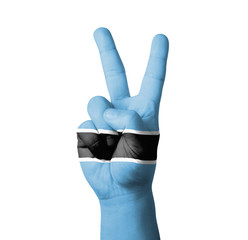 Hand making the V sign, Botswana flag painted