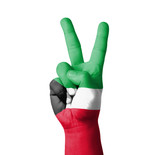 Hand making the V sign, Kuwait flag painted