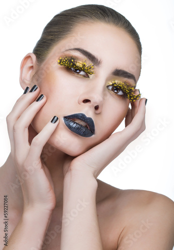 beauty woman with long yellow lashes and black lips