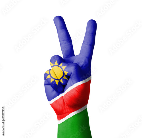 Hand making the V sign, Namibia flag painted