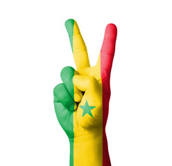 Hand making the V sign, Senegal flag painted