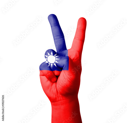 Hand making the V sign, Taiwan flag painted