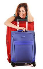 Young woman with travel suitcases. Tourist ready for a trip