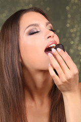Portrait of beautiful young girl with chocolate candy