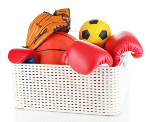 Plastic basket with sports equipment isolated on white