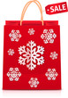 Red Christmas shopping bag with paper snowflakes
