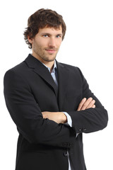 Attractive young businessman posing with folded arms