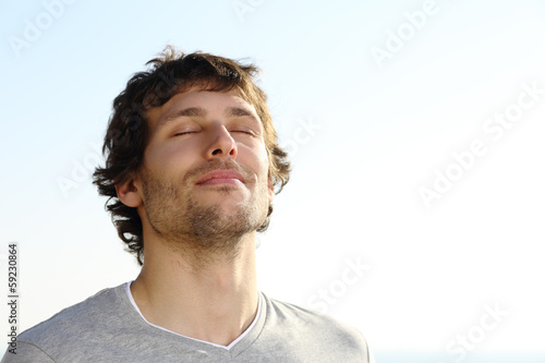 Leinwanddruck Bild Attractive man breathing outdoor